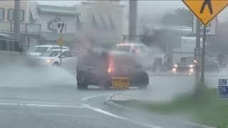 Marine Veteran Jumps Into Action Pushing Car Stranded In Rush Hour Rain