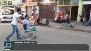 مصر العربية | شاب يتفوق على إعاقته ويستخدم الهاتف بقدمه المبتورة