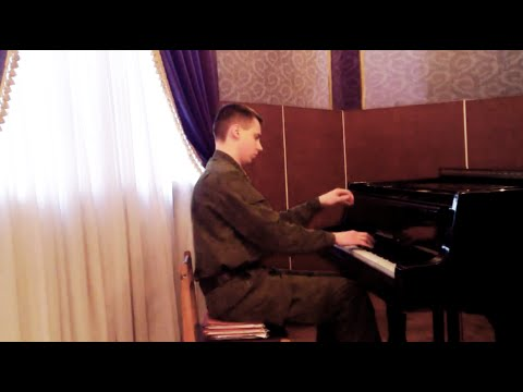 Russian soldier plays Lizst on the piano