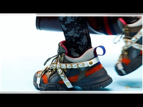 Fashion and sport brands clash in luxury sneakers race