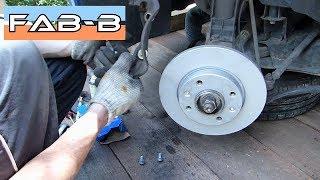 Comment changer les disques et plaquettes de freins sur Peugeot 206 1.4i