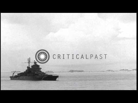 US Marine officers observe through binoculars from the deck of a ship and bombard...HD Stock Footage