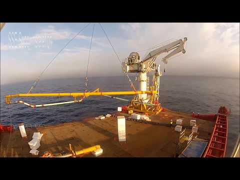 Subsea spool installation with patented overboarding rail system