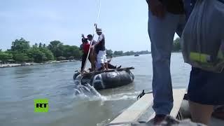 Nueva caravana centroamericana cruza el río Suchiate hacia México