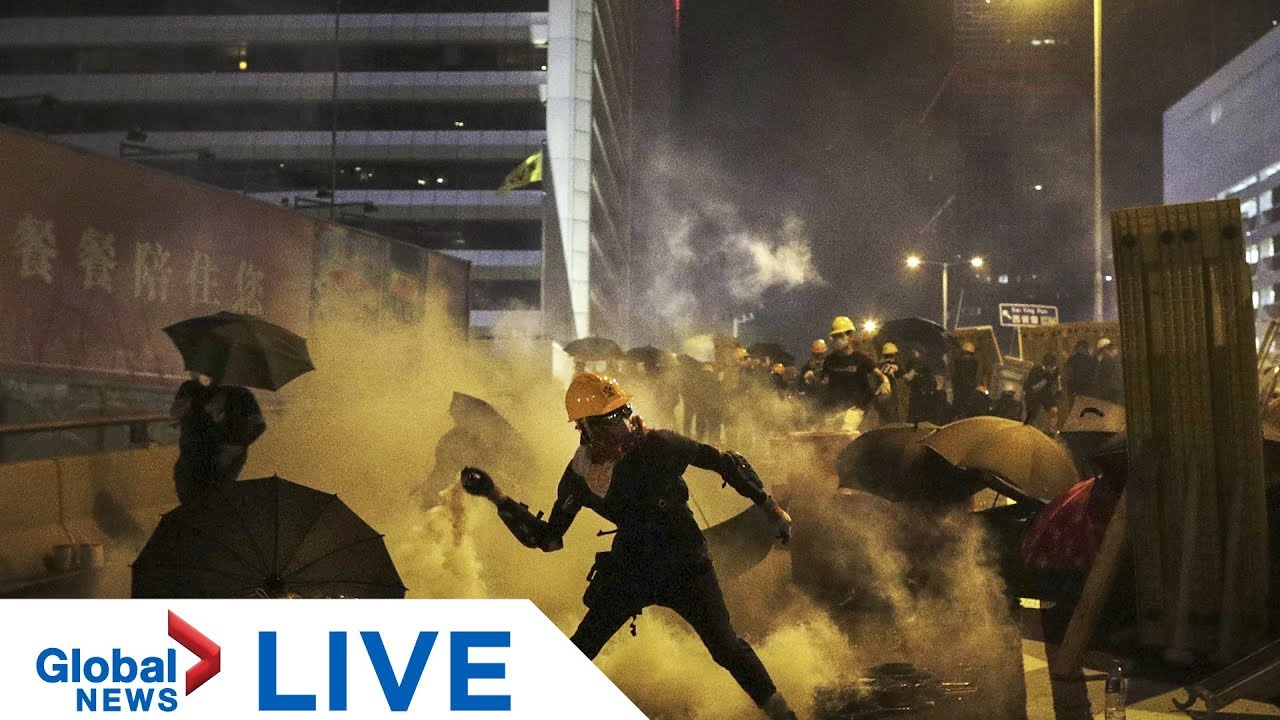 Hong Kong protesters gather outside police station | LIVE
