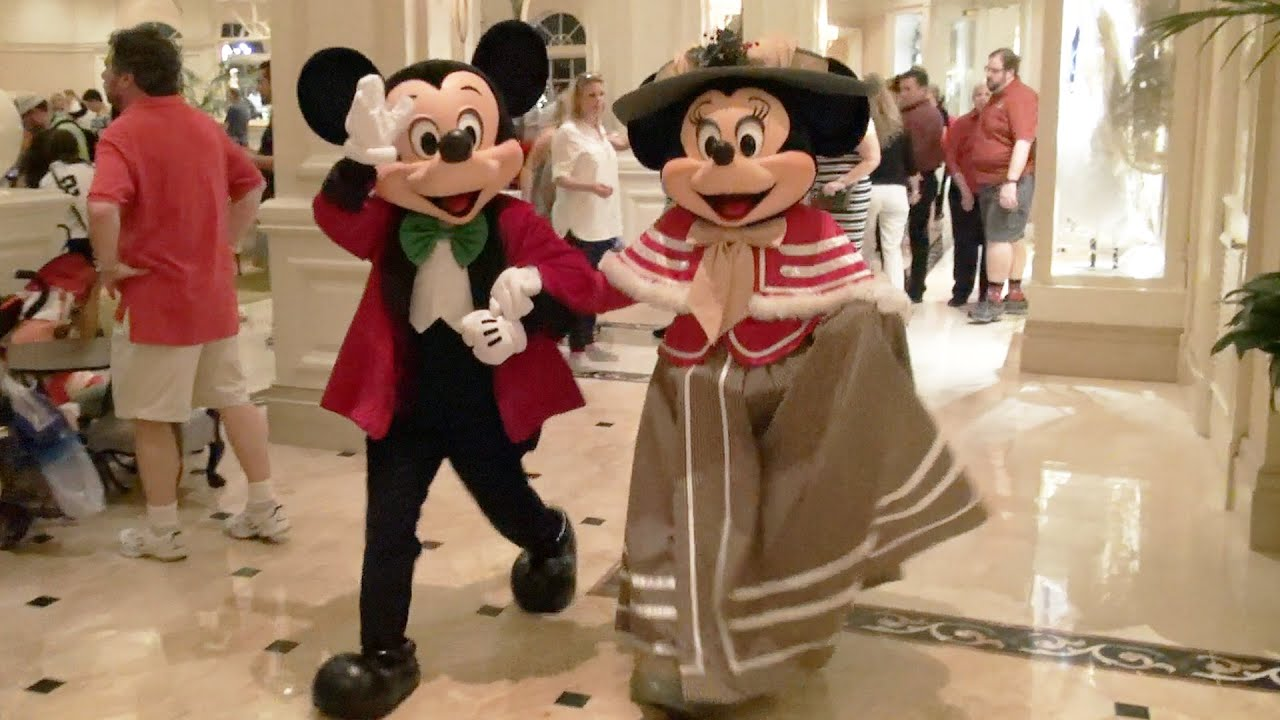 Mickey  Minnie Mouse Meet in Victorian Holiday Outfits on Christmas Eve at Disneys Grand