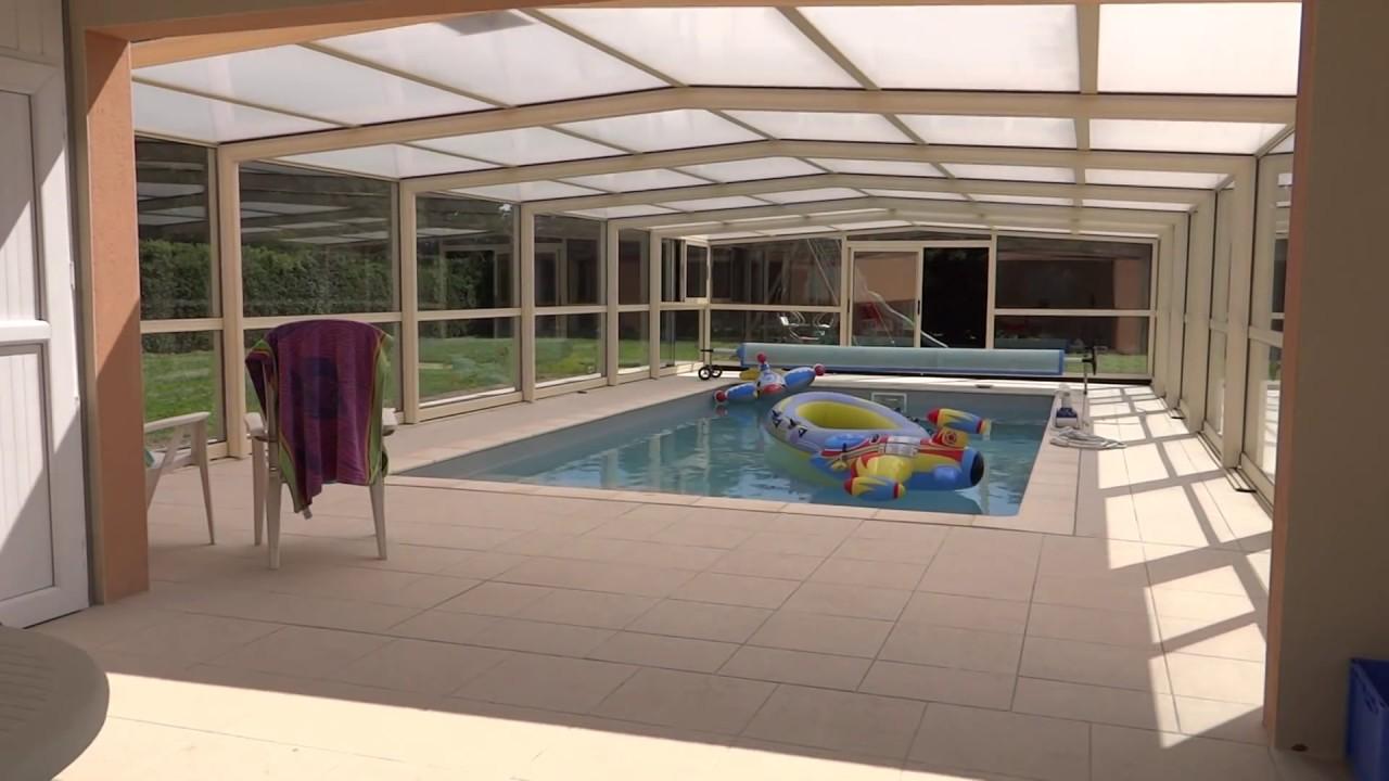 Abri haut t lescopique pour piscine youtube for Piscine design concept