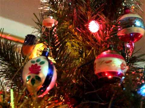 Old Fashioned Christmas ornaments and flashing spinning light tree topper