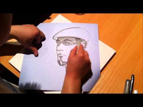 Artist Harrison Chua draws comicbook writer Tom Taylor