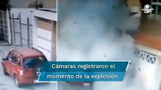 Cámaras de video vigilancia privadas y públicas registran el momento en que un sujeto, a pie, se dirige a la casa habitación cargando una caja de regalo y la deja en el portón