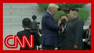 Trump and Kim Jong Un shake hands at DMZ