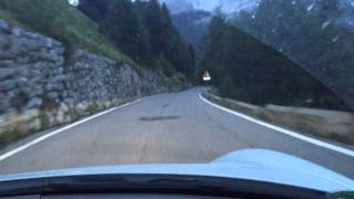 Audi RS6 and Porsche 911 4S in Stelvio at dawn