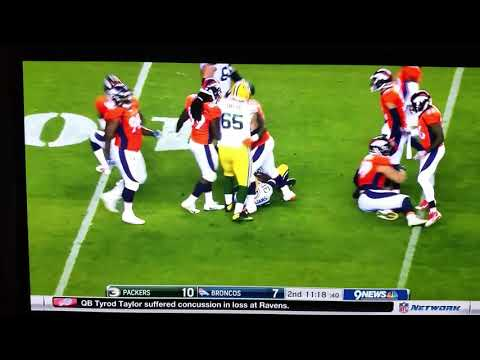 Todd Davis #51 Denver Broncos fighting with Packers