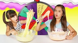 MYSTERY WHEEL OF SLIME CHALLENGE - SIS vs SIS  Emily and Evelyn