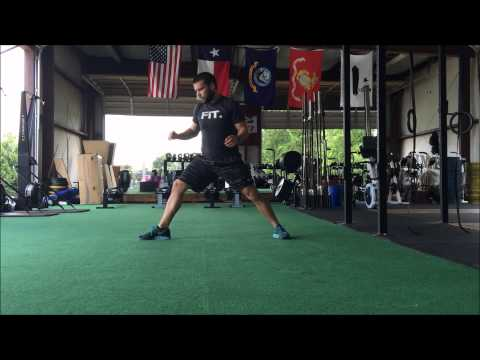 Cossack + low lunge with twist warm up flow