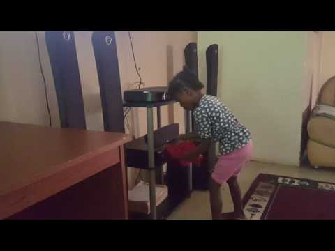 African daughter cleaning the house