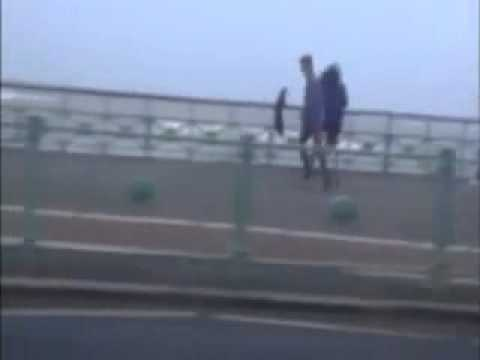 Skateboarder uses Umbrella to zoom along Brighton seafront