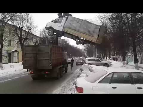 Slav truck lifting another truck to load it onto itself