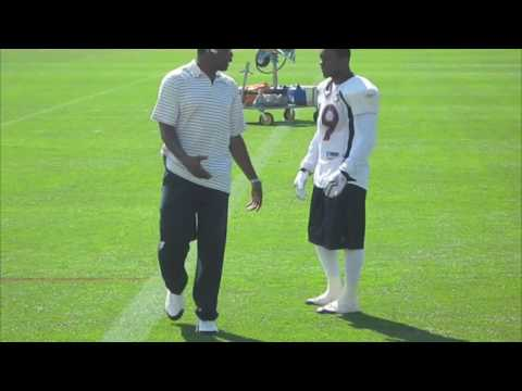 Eddie Royal getting tips from Rod Smith