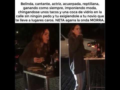 Belinda comiendo tacos en la calle y cantando cumbias