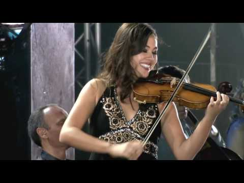 Mary Simspon performs with her joyful smile on Yanni's The Rain Must Fall