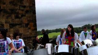 Sunshine Panners Steel Band performing Three Little Birds