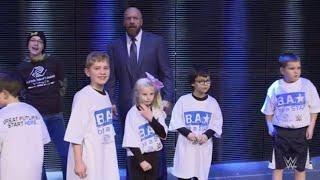 Triple H lets kids from Boys & Girls Clubs of America charge the ring