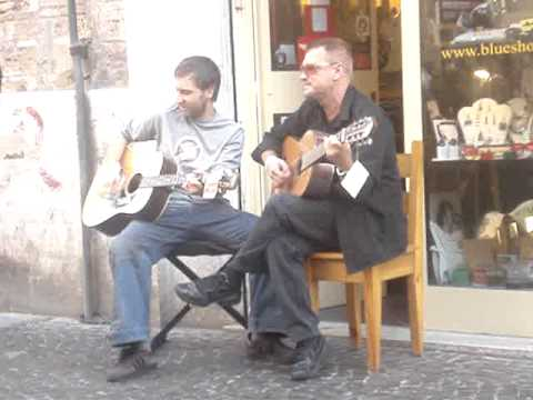 Bono singing on the street in Rome