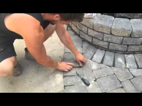 Solar Paver Light Retrofit Installation In A Concrete Paver Sidewalk  iPod & iPhone