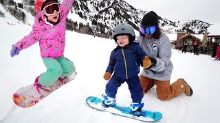NiKO LEARNS TO SHRED!! Family Snow Day routine boarding with the Kids and Adley does her first jump!