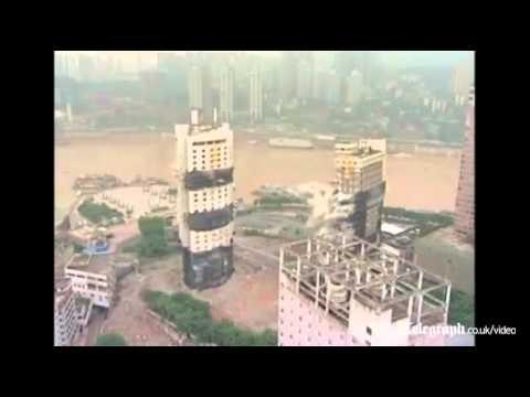 Hai tòa nhà chọc trời đổ sập trong tích tắc   www canhoban net