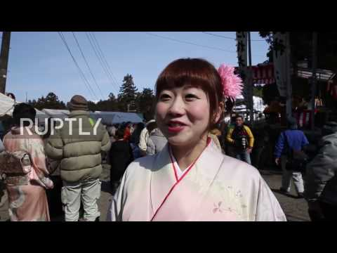 Japan: Hodare fertility festival sees women ride giant wooden phallus