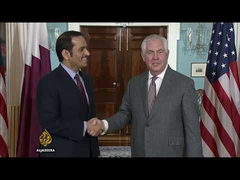 Qatar foreign minister shakes hands with US foreign minister.
