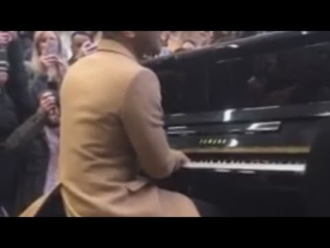 John Legend surprises commuters in London