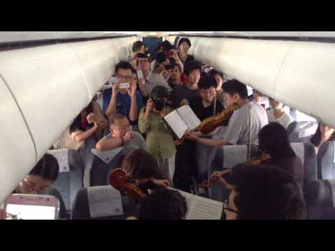 Philadelphia Orchestra musicians perform on flight waiting on Beijing tarmac.