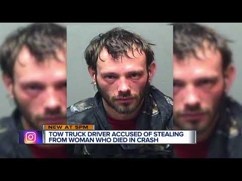 Tow driver arrested; bought car insurance, pizza with accident victim's bank card
