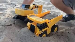 Digger and Dump Truck stuck in sand