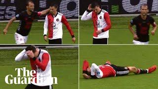 Feyenoord's Steven Berghuis goes down 'injured' after pat on head