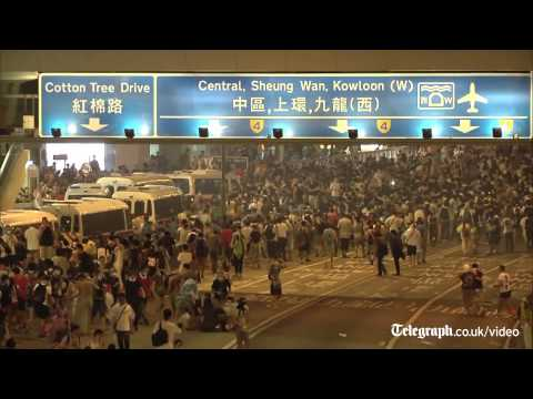 Hong Kong police resort to tear gas to break up democracy protesters