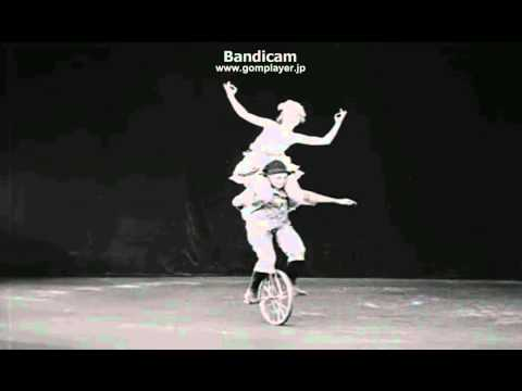 Men and Woman Performing Tricks on Bike and Unicycle