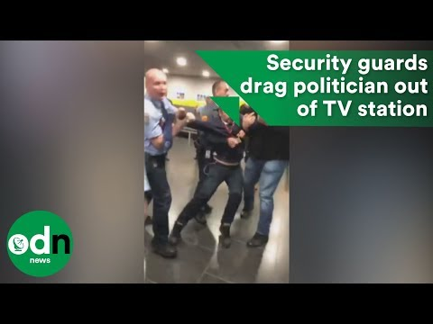 Security guards drag politician out of Hungarian TV station