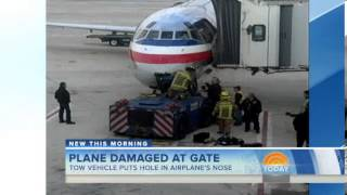 Tow vehicle crashes into airplane at gate