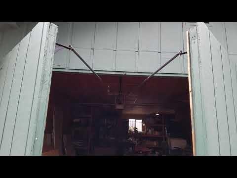 Garage door opener on split carriage barn doors