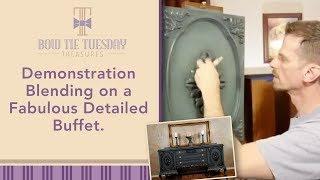 Blending demonstration on a classy buffet's decorative door panel