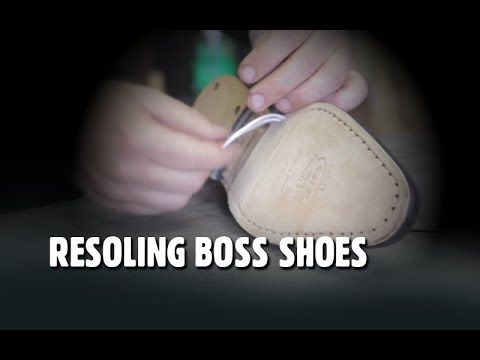 Resoling Boss shoes.