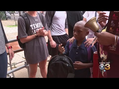 300 Students At Paul L. Dunbar School Receive New Backpacks Filled With School Supplies