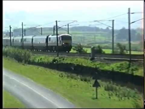 Class 90 heads a northbound train at Scout Green. 1998.