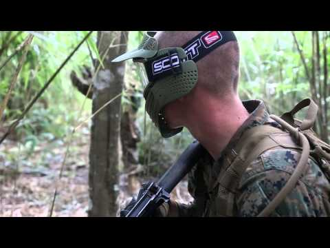 Marines patrol through the jungle