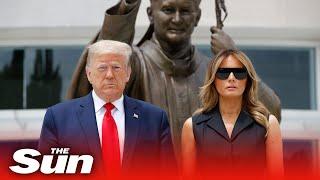Donald Trump 'tells Melania to smile' at Saint John Paul II National Shrine in Washington