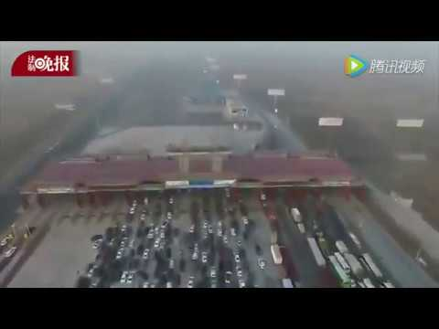 Drone footage captures jaw-dropping traffic jam at the expressway toll stations in Beijing & Hebei